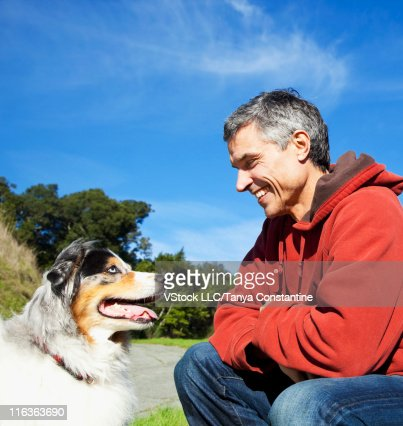USA, California, Fairfax, Smiling man with Border Collie in park : Stock Photo