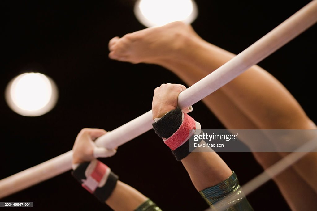USA, California, female gymnast on uneven bars, close-up : Stock Photo