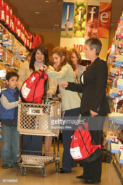 California First Lady Maria Shriver helps a mother and son pick out an American Red Cross Emergency Preparedness Starter Kit at Monday's kickoff of...