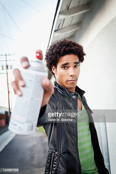 USA, California, Gardena, Portrait of man holding spray paint