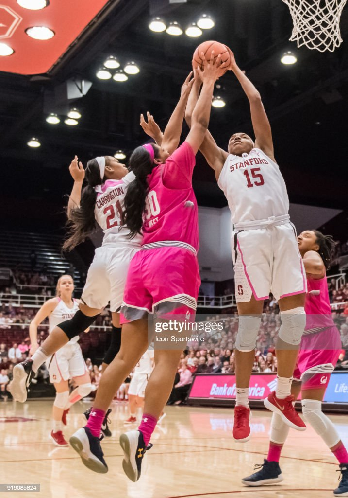California Golden Bears center CJ West (30) and Stanford Cardinal forward Maya Dodson (15) battle for a rebound under the basket during the game between the California Golden Bears and the Stanford Cardinals on Thursday, February 15, 2018 at Maples Pavilion, Stanford, CA.