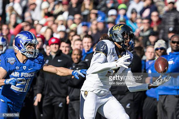 California Golden Bears wide receiver Maurice Harris catches a pass for a first down over Air Force Falcons defensive back Jesse Washington during...