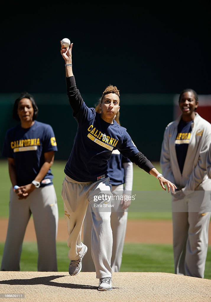 California Golden Bears women's basketball star Layshia Clarendon throws out the ceremonial first pitch before the Oakland Athletics game against the Houston Astros at O.co Coliseum on April 17, 2013 in Oakland, California.