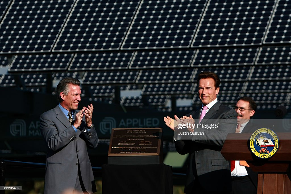 California Gov Arnold Schwarzenegger and Applied Materials CEO Michael Splinter applaud after a dedication ceremony for the company's new rooftop...