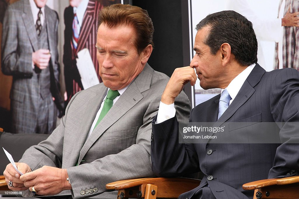 California Gov. Arnold Schwarzenegger (L) and Los Angeles Mayor Antonio Villaraigosa attend the re-opening of the Universal Studios 'New York Street' back lot at Universal Studios Hollywood on May 27, 2010 in Universal City, California.