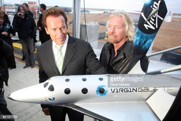 California Gov Arnold Schwarzenegger and Sir Richard Branson stand next to a model as Virgin Galactic unveils its new SpaceShipTwo spacecraft at the...