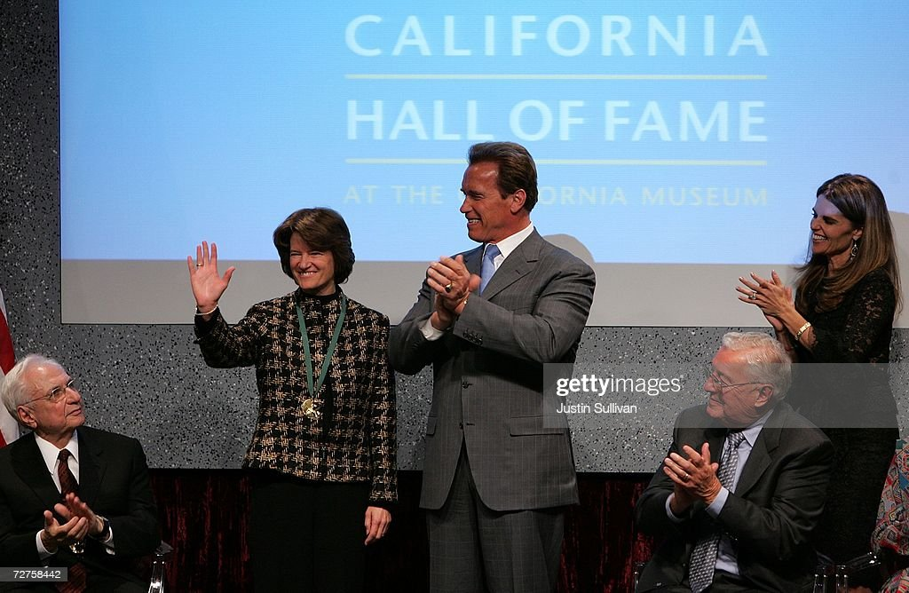 California Gov. Arnold Schwarzenegger applauds former astronaut Sally Ride after she was inducted into the California Hall of Fame December 6, 2006 in Sacramento, California. The Hall of Fame, which was conceived by California first lady Maria Shriver, is inducting Ride, Alice Walker, Billie Jean King, Ronald Reagan, Cesar Chavez, Walt Disney, Amelia Earhart, Clint Eastwood, Frank Gehry, David D. Ho, John Muir and the Hearst and Packard families.