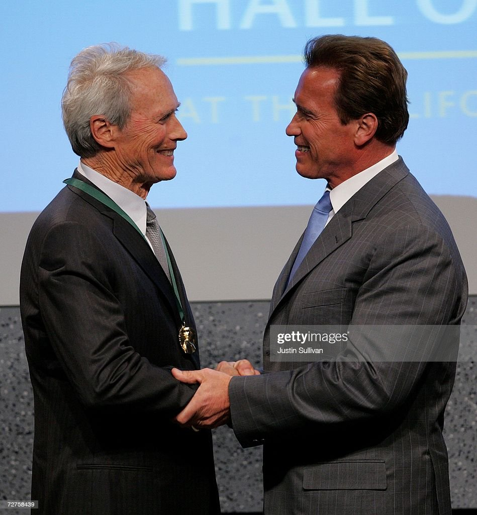 California Gov. Arnold Schwarzenegger (R) shakes hands with actor Clint Eastwood after Eastwood was inducted into California Hall of Fame December 6, 2006 in Sacramento, California. The Hall of Fame, which was conceived by California first lady Maria Shriver, is inducting Eastwood, Frank Gehry, Alice Walker, Ronald Reagan, Cesar Chavez, Walt Disney, Amelia Earhart, Frank Gehry, David D. Ho, Billie Jean King, John Muir, Sally Ride and the Hearst and Packard families.