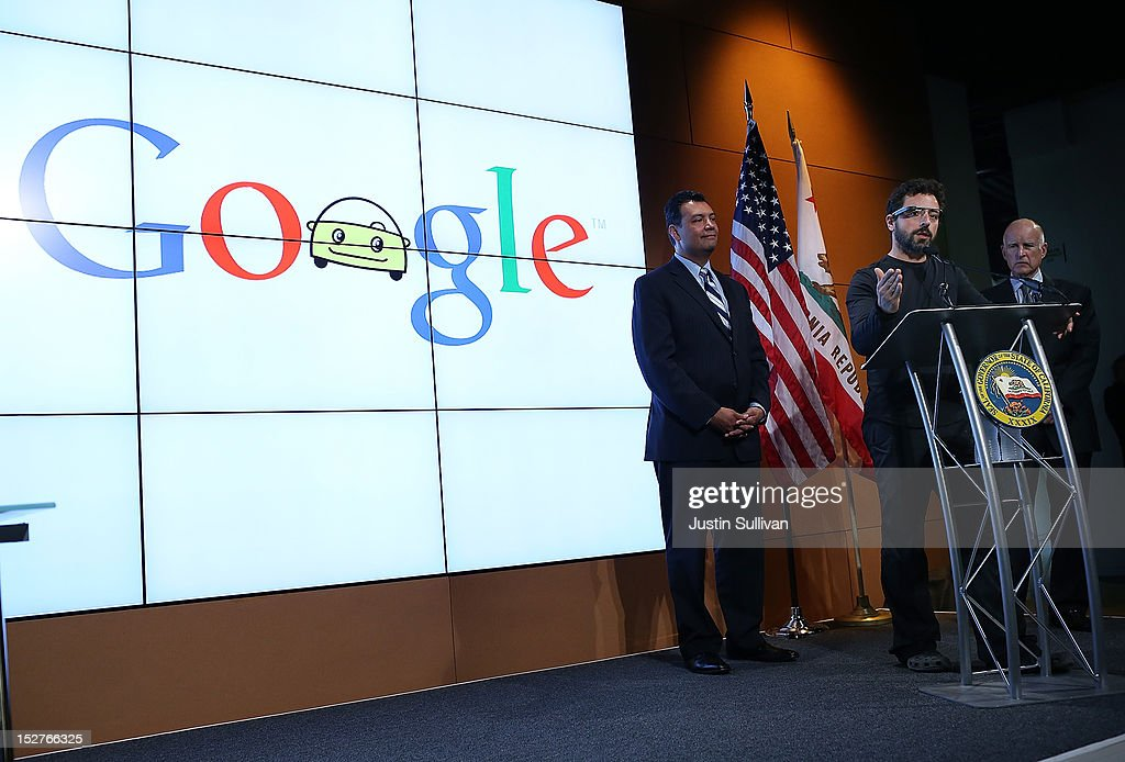 California Gov. Jerry Brown (R) and California State Sen. Alex Padilla (L) look on as Google co-founder Sergey Brin (C) speaks during a news conference at the Google headquarters on September 25, 2012 in Mountain View, California. California Gov. Jerry Brown signed State Senate Bill 1298 that allows driverless cars to operate on public roads for testing purposes. The bill also calls for the Department of Motor Vehicles to adopt regulations that govern licensing, bonding, testing and operation of the driverless vehicles before January 2015.
