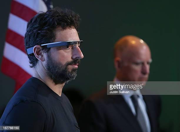 California Gov Jerry Brown and Google cofounder Sergey Brin look on during a news conference at Google headquarters on September 25 2012 in Mountain...