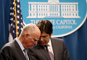 California Gov Jerry Brown and Senate President pro Tempore Kevin de Leon share notes during a news conference to announce emergency drought...