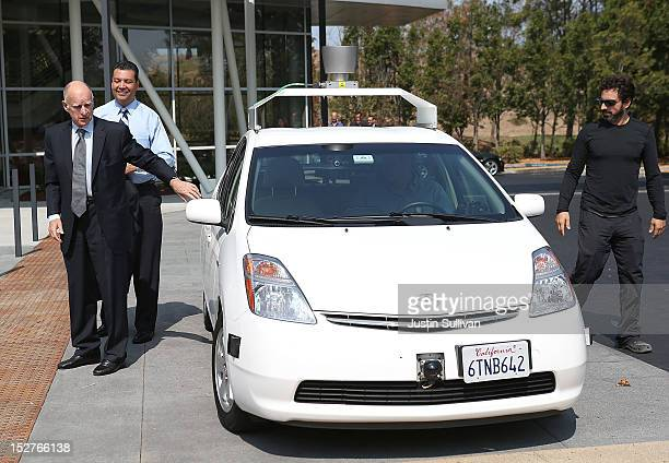California Gov Jerry Brown California State Sen Alex Padilla and Google cofounder Sergey Brin exit a selfdriving car at the Google headquarters on...