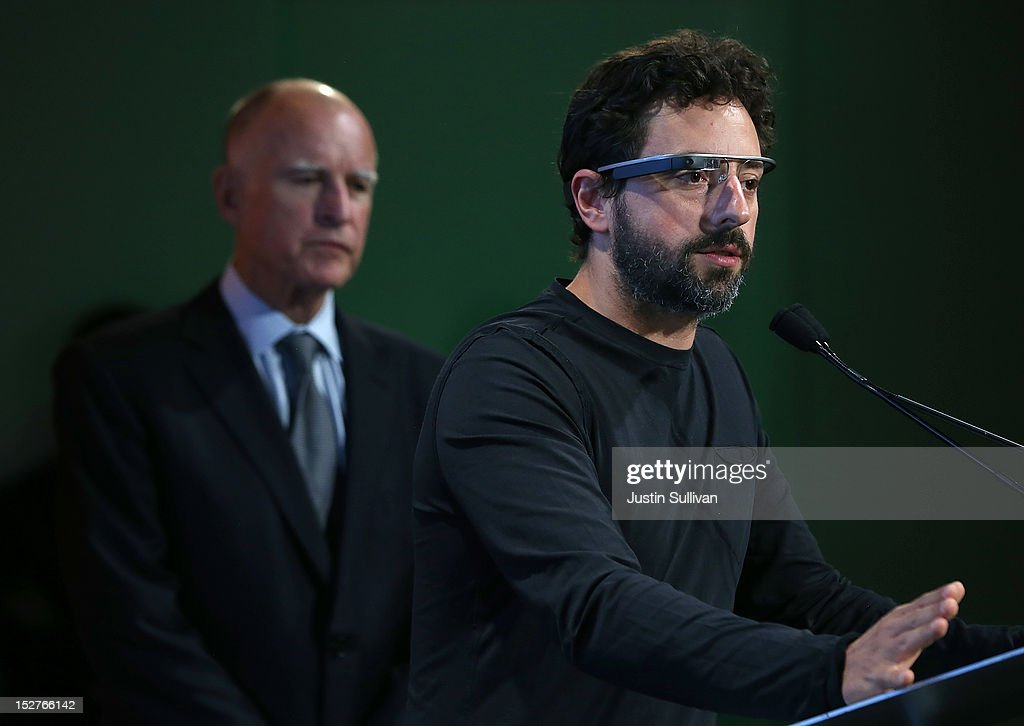 California Gov. Jerry Brown (L) looks on as Google co-founder Sergey Brin speaks during a news conference at Google headquarters on September 25, 2012 in Mountain View, California. California Gov. Jerry Brown signed State Senate Bill 1298 that allows driverless cars to operate on public roads for testing purposes. The bill also calls for the Department of Motor Vehicles to adopt regulations that govern licensing, bonding, testing and operation of the driverless vehicles before January 2015.