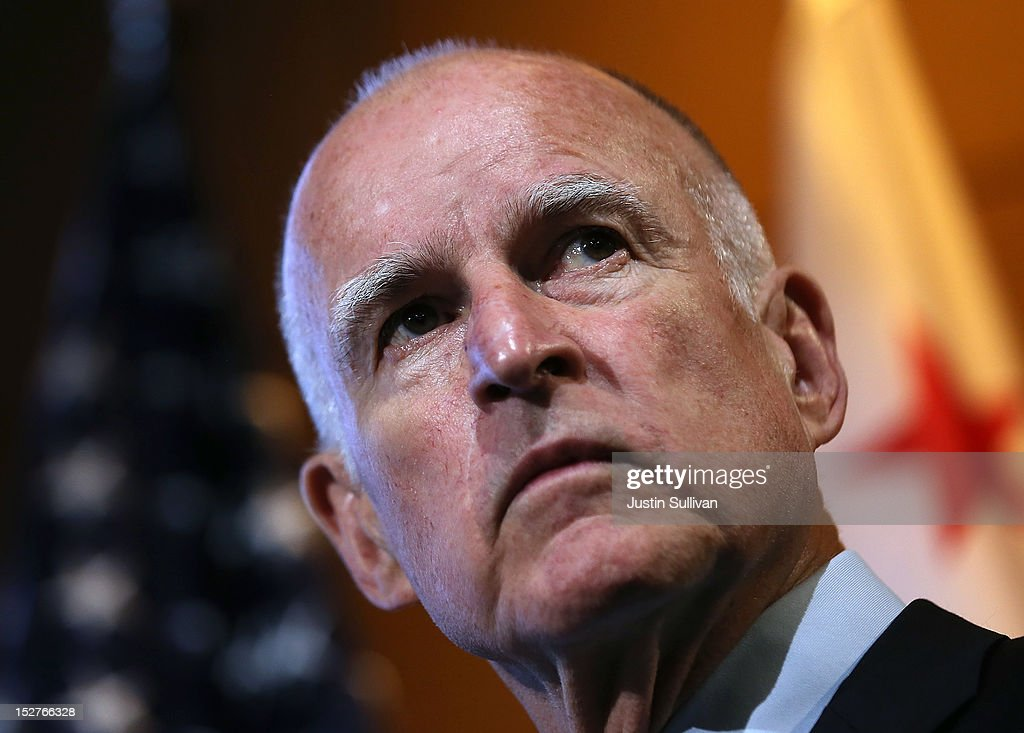 California Gov. Jerry Brown looks on during a news conference at Google headquarters on September 25, 2012 in Mountain View, California. California Gov. Jerry Brown signed State Senate Bill 1298 that allows driverless cars to operate on public roads for testing purposes. The bill also calls for the Department of Motor Vehicles to adopt regulations that govern licensing, bonding, testing and operation of the driverless vehicles before January 2015.