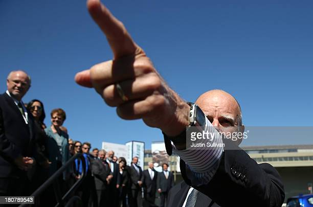 California Gov Jerry Brown points as he walks on stage before speaking during the Drive The Dream event at the Exploratorium on September 16 2013 in...
