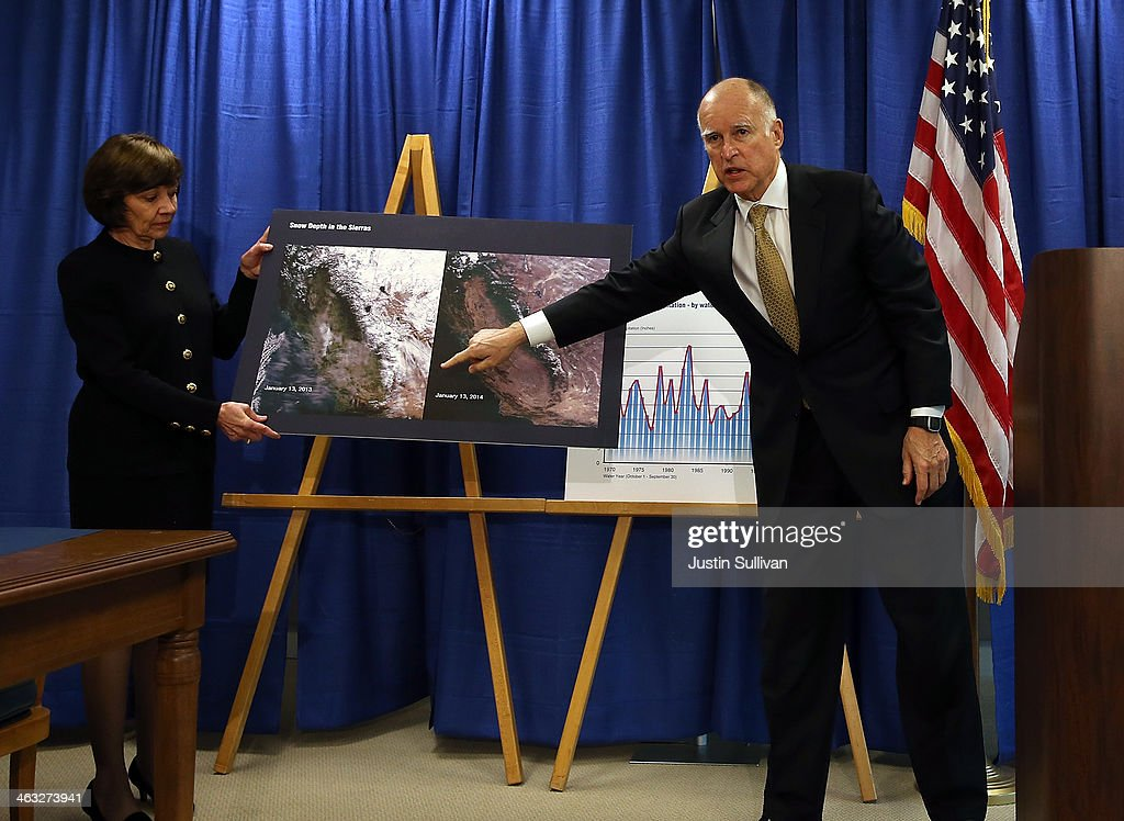 California Gov. Jerry Brown points to satellite images of past and current snow coverage as he speaks during a news conference on January 17, 2014 in San Francisco, California. Gov. Brown declared a drought state of emergency for California as the state faces water shortfalls in what is expected to be the driest year in state history. Residents are being asked to voluntarily reduce water usage by 20%.