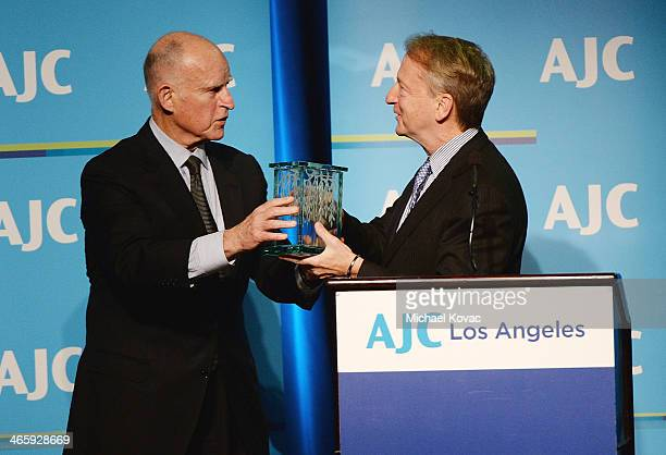 California Gov Jerry Brown presents honoree David Bohnett with the AJC Los Angeles' Ira E Yellin Community Leadership Award at Regent Beverly...