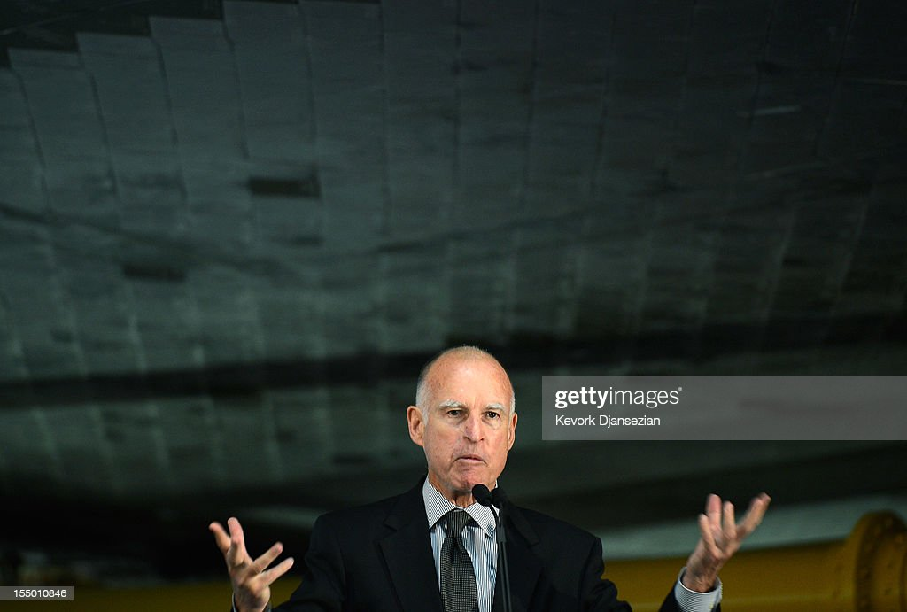 California Gov. <a gi-track='captionPersonalityLinkClicked' href=/galleries/search?phrase=Jerry+Brown&family=editorial&specificpeople=217599 ng-click='$event.stopPropagation()'>Jerry Brown</a>, standing under the tile-covered bottom of the space shuttle Endeavour, speaks during the grand opening ceremony of the Endeavour exhibit at the new Samuel Oschin Pavilion of the California Science Center on October 30, 2012 in Los Angeles, California. The Orbiter arrived in Los Angeles in late September atop a modified Boeing 747. Then earlier this month nearly 1 million spectators looked on as Endeavour was transported on city streets during a three-day 11-mile journey from Los Angeles International Airport to the Science Center.