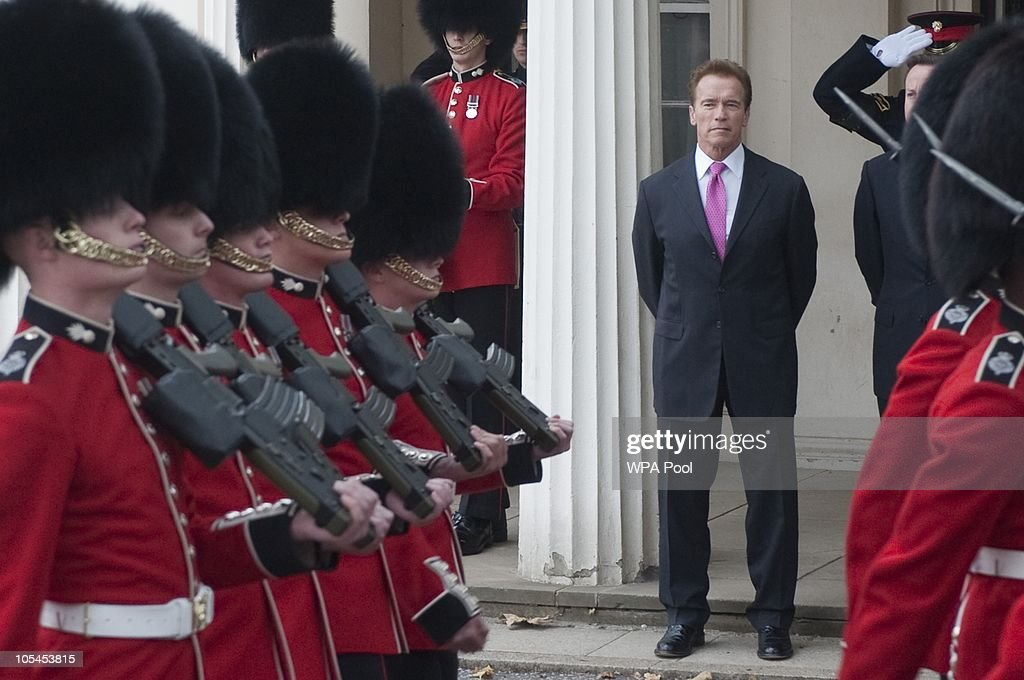 California Governor Arnold Schwarzenegger and Britsh Prime Minister David Cameron (not pictured) watch troops at Wellington Barracks on October 14, 2010 in London, England. Mr Cameron and Mr Schwarzenegger will meet British troops later today at Wellington Barracks in central London.