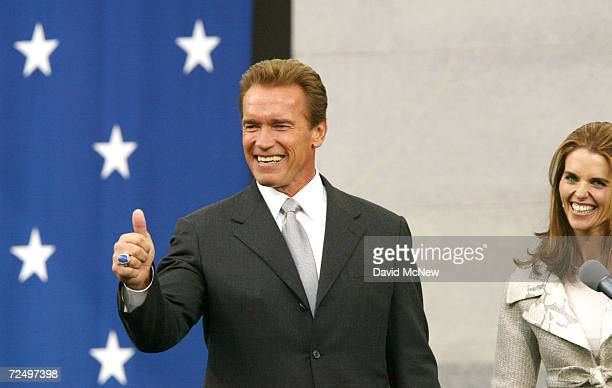 California Governor Arnold Schwarzenegger and first lady Maria Shriver rejoice after taking the Oath of Office November 17 2003 in Sacramento...
