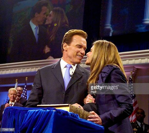 California governor Arnold Schwarzenegger and his wife Maria Shriver kiss after he was sworn in for second term on January 5 2007 in Sacramento...