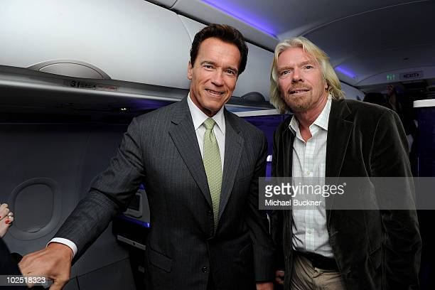 California Governor Arnold Schwarzenegger and Sir Richard Branson fly on Virgin America's first international flight to Toronto on June 29 2010 in...