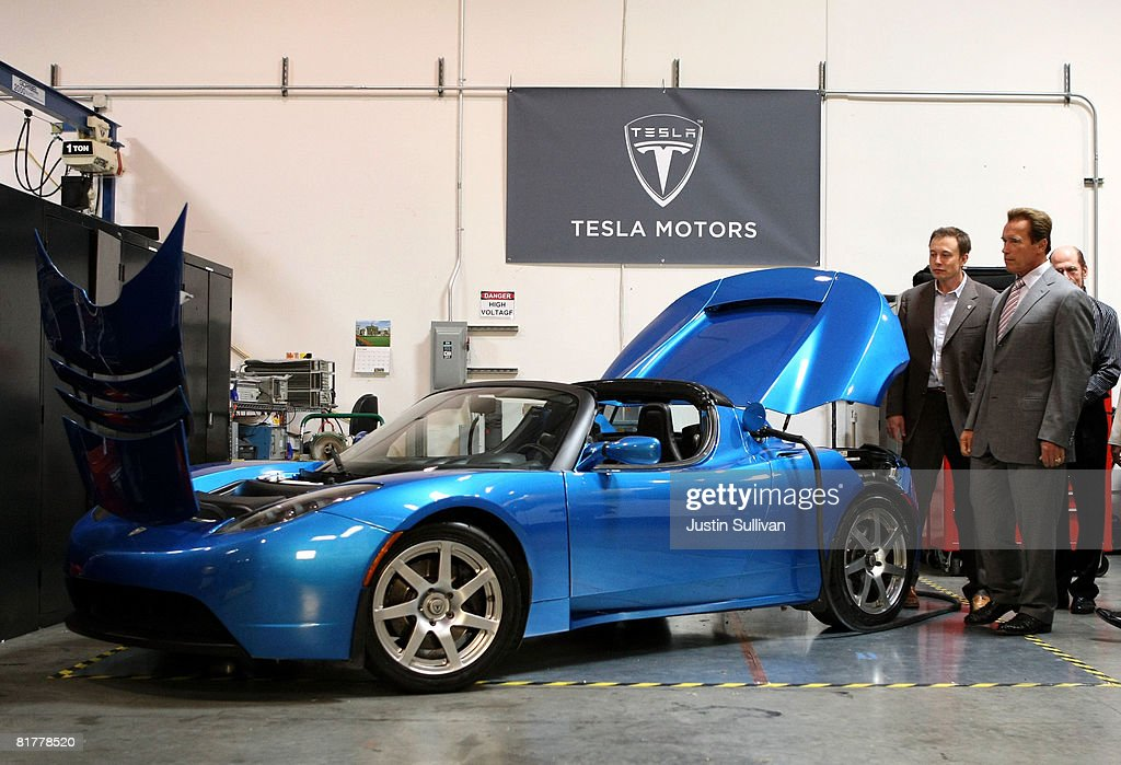 California governor <a gi-track='captionPersonalityLinkClicked' href=/galleries/search?phrase=Arnold+Schwarzenegger&family=editorial&specificpeople=156406 ng-click='$event.stopPropagation()'>Arnold Schwarzenegger</a> (R) and Tesla Motors Product Architect and Engineer Elon Musk look at a Tesla Roadster before a news conference June 30, 2008 at Tesla Motors in San Carlos, California. Governor Schwarzenegger announced that electric car company Tesla Motors will build a new manufacturing facility in California to manufacture its all-electric Tesla Roadster. The $109,000 2009 Tesla Roadster zero emissions vehicle is capable of traveling nearly 250 miles on a single charge and is capable of going 0-60 miles per hour in 3.9 seconds.