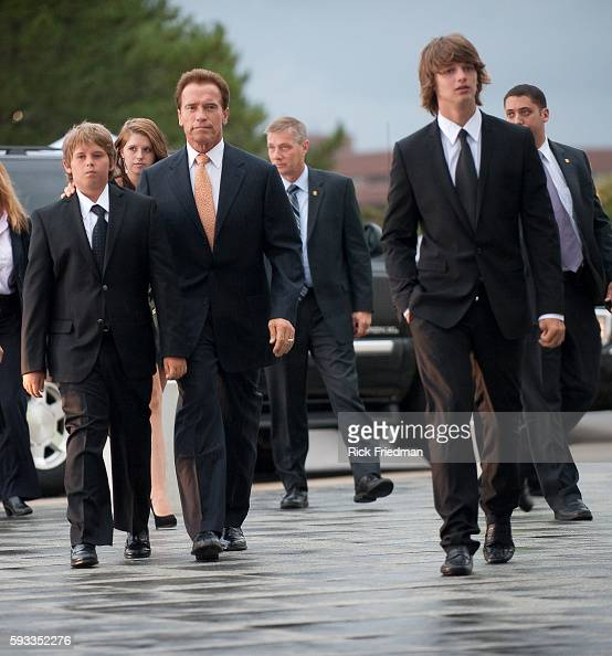 California Governor Arnold Schwarzenegger arriving at the memorial for Senator Edward M 'Ted' Kennedy with his sons Patrick and Christopher and his...