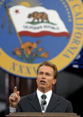 California Governor Arnold Schwarzenegger delivers his inaugural address on the steps of the State Capitol November 17 2003 in Sacramento California...