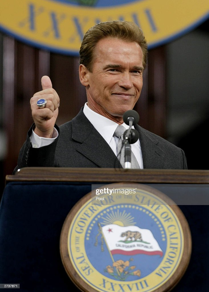 California Governor Arnold Schwarzenegger gives a thumbsup at the conclusion of his speech during his inaugural at the State Capitol November 17 2003...