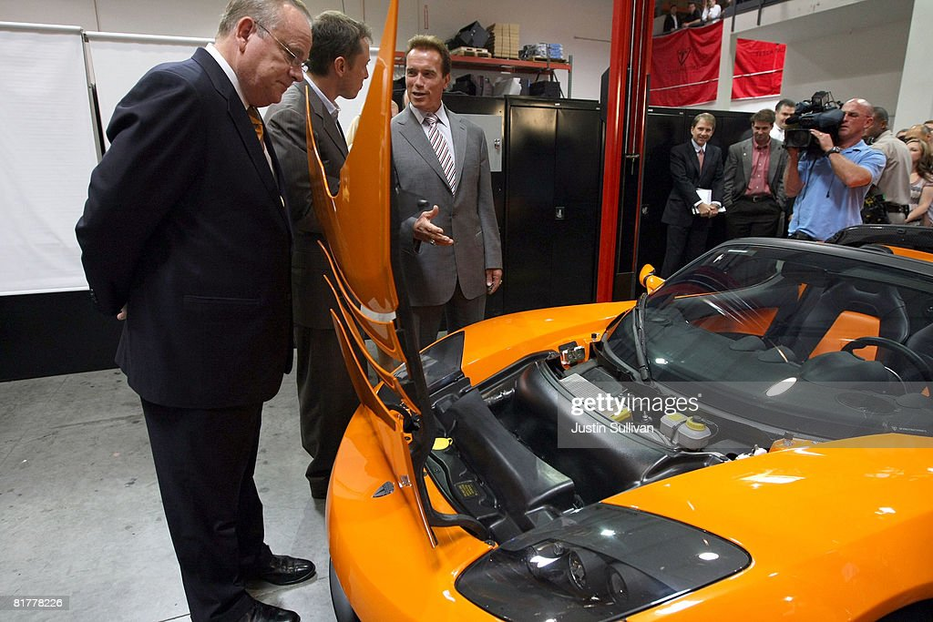 California governor <a gi-track='captionPersonalityLinkClicked' href=/galleries/search?phrase=Arnold+Schwarzenegger&family=editorial&specificpeople=156406 ng-click='$event.stopPropagation()'>Arnold Schwarzenegger</a> (R) looks at a Tesla Roadster with California State Treasurer Bill Lockyer (L) and Tesla Motors Product Architect and Engineer Elon Musk before a news conference June 30, 2008 at Tesla Motors in San Carlos, California. Governor Schwarzenegger announced that electric car company Tesla Motors will build a new manufacturing facility in California to manufacture its all-electric Tesla Roadster. The $109,000 2009 Tesla Roadster zero emissions vehicle is capable of traveling nearly 250 miles on a single charge and is capable of going 0-60 miles per hour in 3.9 seconds.