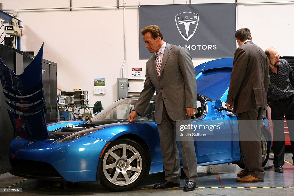 California governor <a gi-track='captionPersonalityLinkClicked' href=/galleries/search?phrase=Arnold+Schwarzenegger&family=editorial&specificpeople=156406 ng-click='$event.stopPropagation()'>Arnold Schwarzenegger</a> looks at a Tesla Roadster before a news conference June 30, 2008 at Tesla Motors in San Carlos, California. Governor Schwarzenegger announced that electric car company Tesla Motors will build a new manufacturing facility in California to manufacture its all-electric Tesla Roadster. The $109,000 2009 Tesla Roadster zero emissions vehicle is capable of traveling nearly 250 miles on a single charge and is capable of going 0-60 miles per hour in 3.9 seconds.