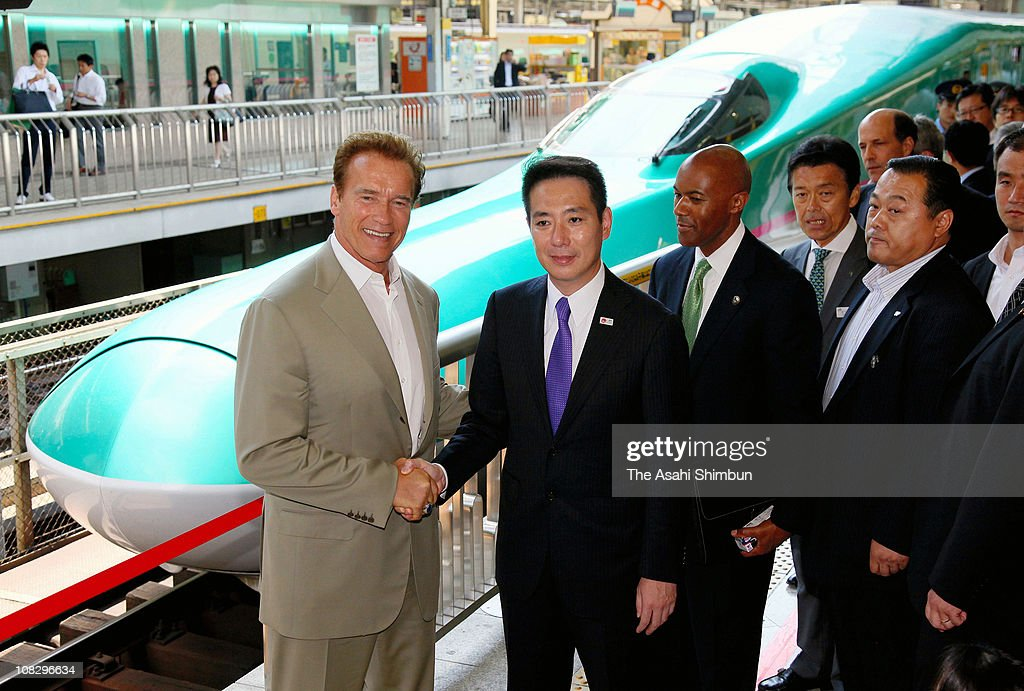 California Governor Arnold Schwarzenegger shakes hands with Japanese Transport Minister Seiji Maehara as they stand next to Shinkansen bullet train at the Tokyo station on September 14, 2010 in Tokyo, Japan.