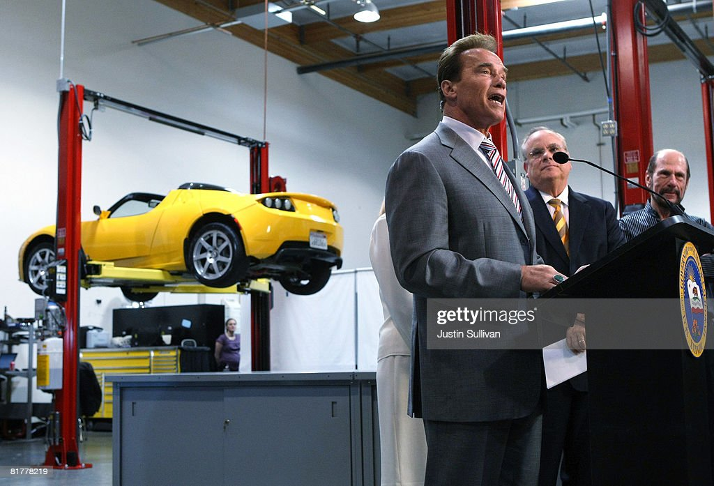 California governor <a gi-track='captionPersonalityLinkClicked' href=/galleries/search?phrase=Arnold+Schwarzenegger&family=editorial&specificpeople=156406 ng-click='$event.stopPropagation()'>Arnold Schwarzenegger</a> (L) speaks as California State Treasurer Bill Lockyer (C) and Tesla Motors President and CEO Ze'ev Drori look on during a news conference June 30, 2008 at Tesla Motors in San Carlos, California. Governor Schwarzenegger announced that electric car company Tesla Motors will build a new manufacturing facility in California to manufacture its all-electric Tesla Roadster. The $109,000 2009 Tesla Roadster is capable of traveling nearly 250 miles on a single charge and is capable of going 0-60 miles per hour in 3.9 seconds.