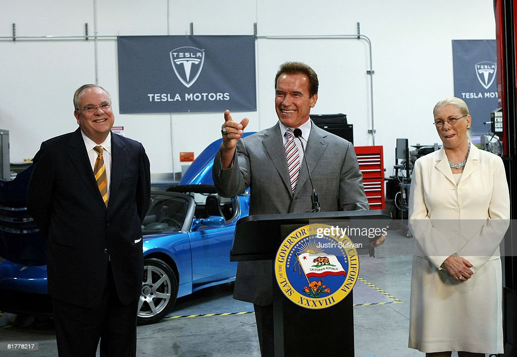 California governor <a gi-track='captionPersonalityLinkClicked' href=/galleries/search?phrase=Arnold+Schwarzenegger&family=editorial&specificpeople=156406 ng-click='$event.stopPropagation()'>Arnold Schwarzenegger</a> (C) speaks during a news conference as California State Treasurer Bill Lockyer (L) and California Secretary of Labor and Workforce Development Vickie Bradshaw (R) look on June 30, 2008 at Tesla Motors in San Carlos, California. Governor Schwarzenegger announced that electric car company Tesla Motors will build a new manufacturing facility in California to manufacture its all-electric Tesla Roadster. The $109,000 2009 Tesla Roadster is capable of traveling nearly 250 miles on a single charge and is capable of going 0-60 miles per hour in 3.9 seconds.