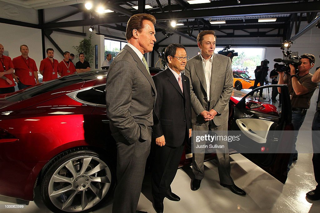 California governor <a gi-track='captionPersonalityLinkClicked' href=/galleries/search?phrase=Arnold+Schwarzenegger&family=editorial&specificpeople=156406 ng-click='$event.stopPropagation()'>Arnold Schwarzenegger</a>, Toyota CEO <a gi-track='captionPersonalityLinkClicked' href=/galleries/search?phrase=Akio+Toyoda&family=editorial&specificpeople=2334399 ng-click='$event.stopPropagation()'>Akio Toyoda</a> and Tesla Motors CEO Elon Musk pose in front of a Tesla Model S before a news conference at Tesla Motors headquarters May 20, 2010 in Palo Alto, California. Electric car maker Tesla Motors annoucned a partnership with Japanese automaker Toyota to make electric cars in the United States. The cars will be manufactured at the recently shuttered NUMMI plant in Fremont, California where Toyota had pulled out after a joint partnership with General Motors had ended.