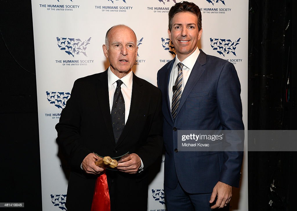 California Governor Jerry Brown (L) and President and Chief Executive Officer of the Humane Society of the United States Wayne Pacelle attend the Humane Society of The United States 60th Anniversary Gala at The Beverly Hilton Hotel on March 29, 2014 in Beverly Hills, California.