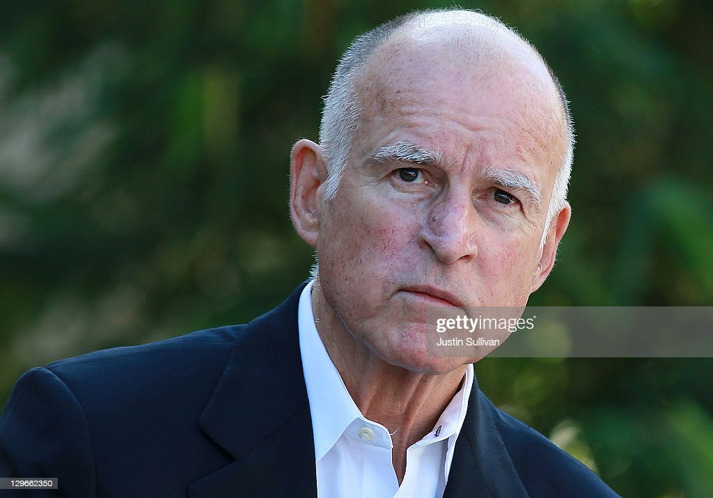 California governor <a gi-track='captionPersonalityLinkClicked' href=/galleries/search?phrase=Jerry+Brown&family=editorial&specificpeople=217599 ng-click='$event.stopPropagation()'>Jerry Brown</a> looks on during a ribbon cutting ceremony to open the new Dell research and development facility on October 19, 2011 in Santa Clara, California. California governor <a gi-track='captionPersonalityLinkClicked' href=/galleries/search?phrase=Jerry+Brown&family=editorial&specificpeople=217599 ng-click='$event.stopPropagation()'>Jerry Brown</a> and Dell Chairman and CEO Michael Dell attended a ribbon cutting to open the new Dell research and development facility that was followed by a career fair to hire hundreds of employees for the new facilty.