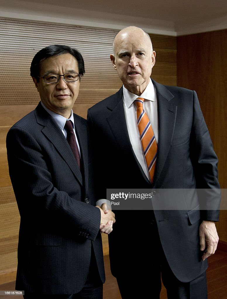 California Governor <a gi-track='captionPersonalityLinkClicked' href=/galleries/search?phrase=Jerry+Brown&family=editorial&specificpeople=217599 ng-click='$event.stopPropagation()'>Jerry Brown</a> (R) shakes hands with China Minister of Commerce Gao Hucheng before a meeting at the Ministry of Commerce on April 10, 2013 in Beijing, China. Brown is in China in an effort to secure Chinese investment in his state of California.