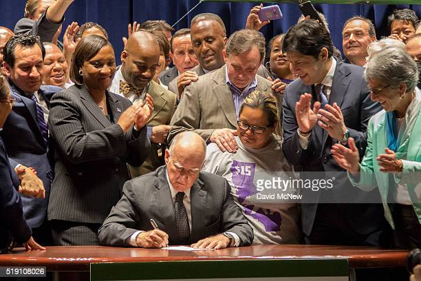 California Governor Jerry Brown signs landmark legislation SB 3 into law on April 4 2016 in Los Angeles California The law makes California the first...
