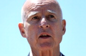 California Governor Jerry Brown speaks during a news conference at the Port of Oakland on July 9 2012 in Oakland California United States Secretary...