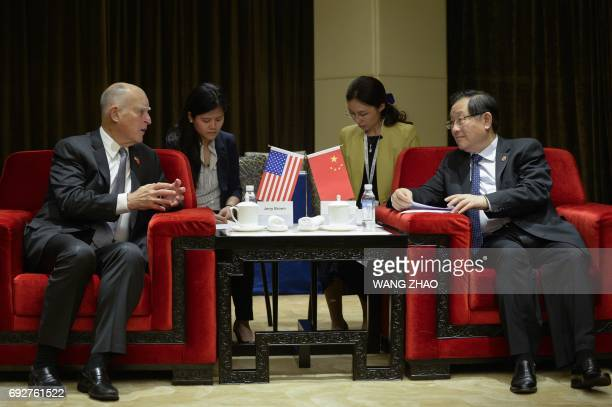 California Governor Jerry Brown speaks with Chinese Minister of Science and Technology Wan Gang during their meeting ahead of the the Clean Energy...