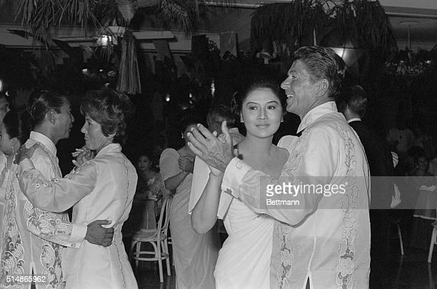 California Governor Ronald Reagan dances with Philippine First Lady Imelda Marcos while President Marcos dances with Nancy Reagan during a state...