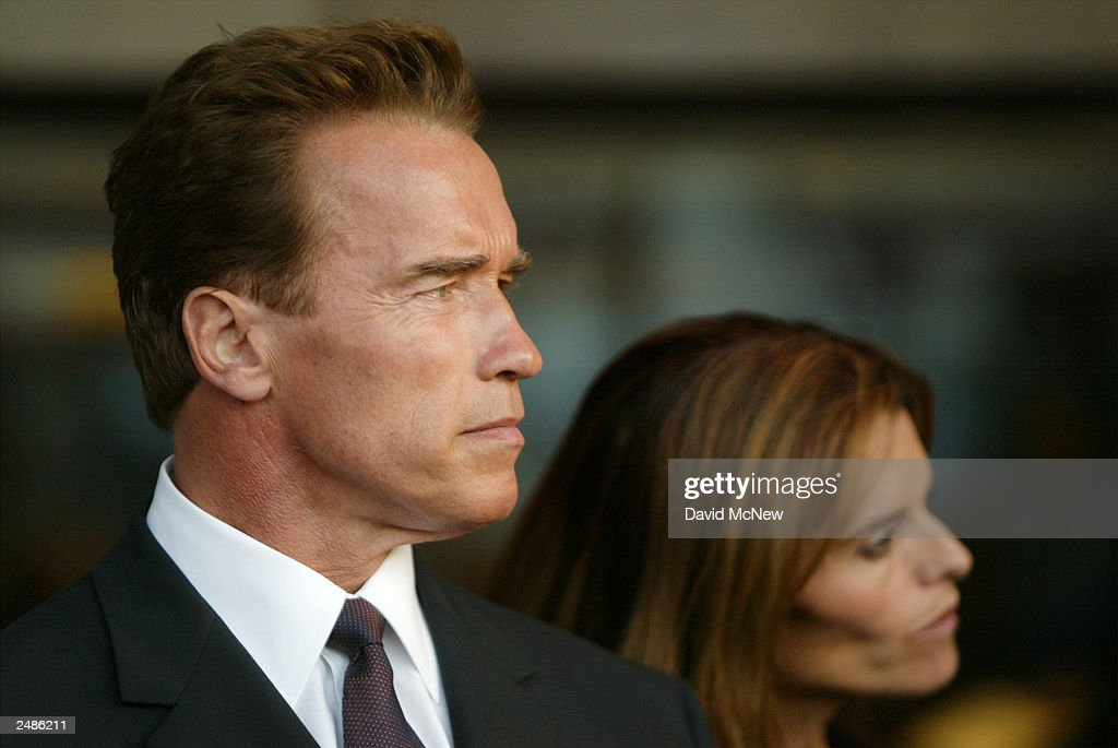 California gubernatorial candidate <a gi-track='captionPersonalityLinkClicked' href=/galleries/search?phrase=Arnold+Schwarzenegger&family=editorial&specificpeople=156406 ng-click='$event.stopPropagation()'>Arnold Schwarzenegger</a> and wife Maria Shriver attend a candle lighting ceremony in honor of those who died in the September 11 terror attacks at the Simon Wiesenthal Center September 11, 2003 in Los Angeles, California. Schwarzenegger is running to replace current governor Gray Davis in the October 7 recall election.