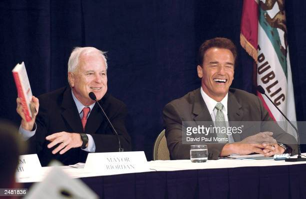 California gubernatorial candidate Arnold Schwarzenegger smiles as former Mayor of Los Angeles Richard Riordan speaks at an education summit...