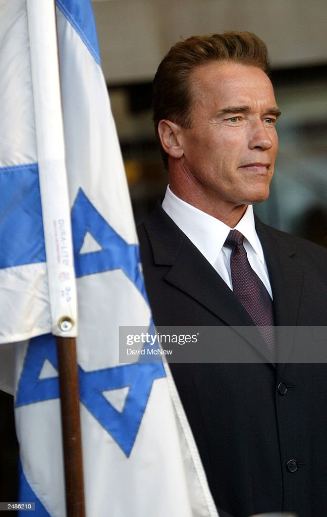 California gubernatorial candidate <a gi-track='captionPersonalityLinkClicked' href=/galleries/search?phrase=Arnold+Schwarzenegger&family=editorial&specificpeople=156406 ng-click='$event.stopPropagation()'>Arnold Schwarzenegger</a> stands near the Star of Davis flag at a candle lighting ceremony in honor of those who died in the September 11 terror attacks at the Simon Wiesenthal Center September 11, 2003 in Los Angeles, California. Schwarzenegger is running to replace current governor Gray Davis in the October 7 recall election.
