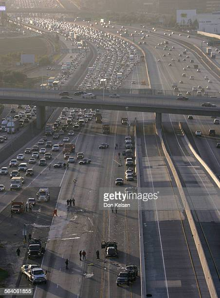 California Highway Patrol and Cal–Trans workers work to reopen the I–5 north bound lands at the El Toro Y North bound traffic is diverted onto the...