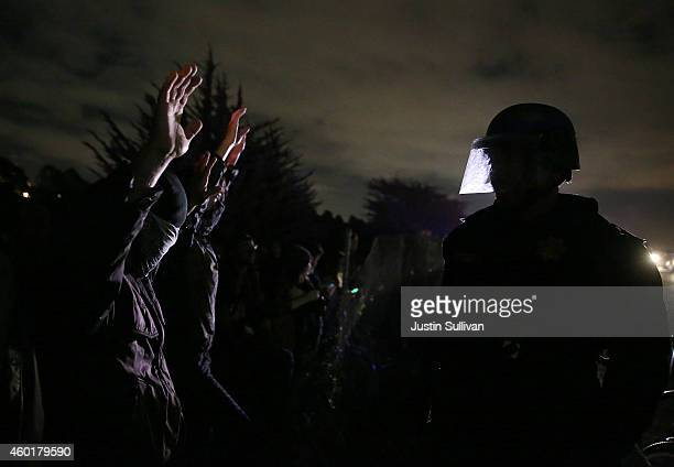 California Highway Patrol officer confronts protesters who were blocking interstate 80 during a demonstration over recent grand jury decisions in...