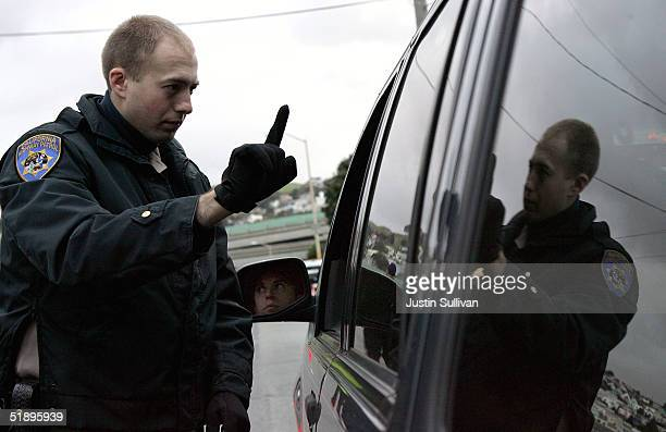California Highway Patrol officer Mike Robinson gives a sobriety test to a man in car at a sobriety checkpoint December 26 2004 in San Francisco...