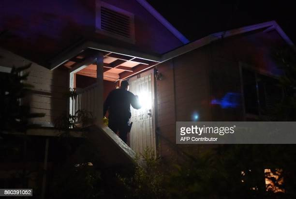 California Highway Patrol officer Steve Rice tags a home as officers announce evacuation advisories in Sonoma California on October 11 2017 Multiple...